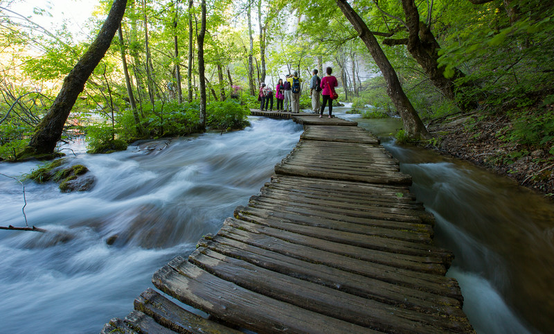 Plitvice National Park, Croatia - water flowing past tourist group