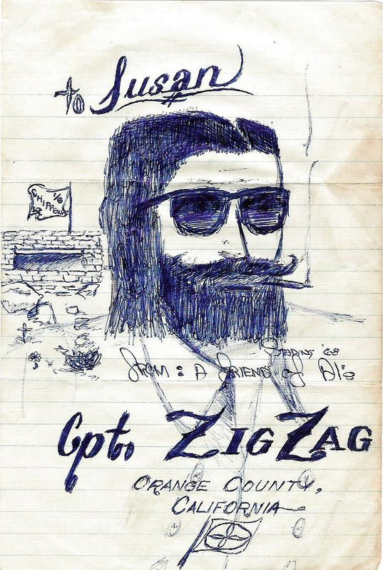 Gary Stading (KIA 25 April 68), drew this rendition of Captain Zig Zag (of cigarette papers fame) in shades for Alan Allen's wife, Susan. The captain is smoking a dinky dow cigarette in front of a bunker with a flag showing 'LZ Chippewa 1/6th.' The art is signed 'From a friend of Al's, Stading '68,' and notes Orange County, California (where Stading was from), and a flag with marijuana leaves on it.
