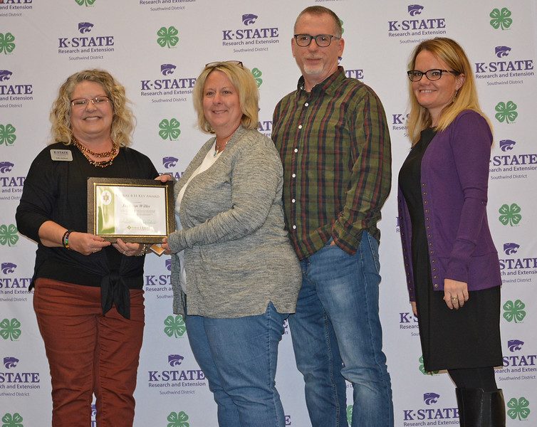 Jill and Jon Wilks, center, receive the Key Award for their son Jackson, who is a student at Kansas State University.