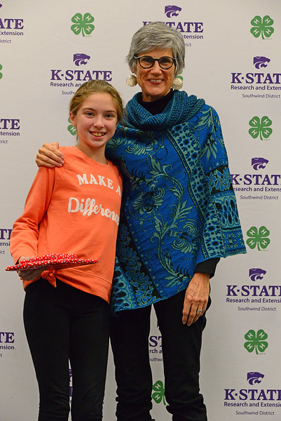 Emilia Wilkerson poses with Susan Lynn of the Register after being recognized as a star reporter for Prairie Dell 4-H.
