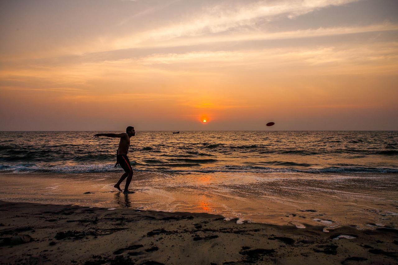 Frisbee player Alleppey beach, Kerala, India