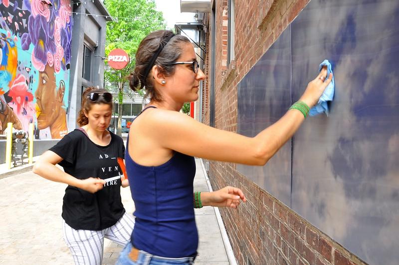 "Eszter Sziksz (black  shirt) Stephanie Cosby ( blue shirt) work on ""Skywalker""in Barboro Alley"