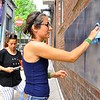 "Eszter Sziksz (black  shirt) Stephanie Cosby ( blue shirt) work on ""Skywalker""in Barboro Alley"