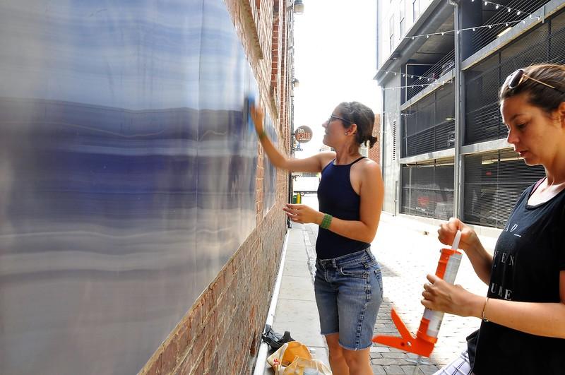 """Eszter Sziksz ( balck Eszter Sziksz (black  shirt) Stephanie Cosby ( blue shirt) work on """"Skywalker"""""""