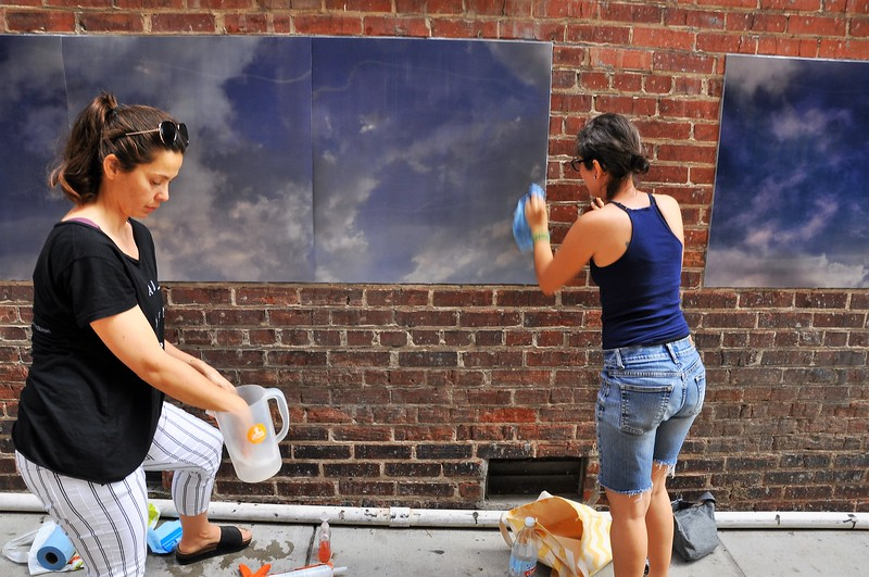 "Eszter Sziksz (black  shirt) Stephanie Cosby ( blue shirt) work on ""Skywalker"" in Barboro Alley"