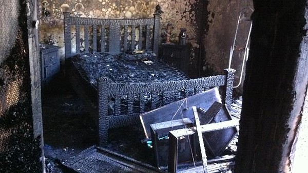 Silhouettes of burnt furniture in amongst the dressing.