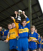 EEjob 13/11/2017 SPORT Allianz Sciath na Scol Finals at Páirc Uí Rinn. Rathduff v GS tSaile Rathduff supporters. Rafduff Captain Fionan O'Riordan holds the cup up high after victory over GS Chionn tSaile. Picture  Andy Jay
