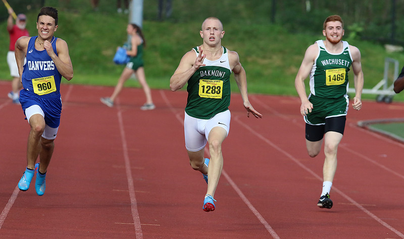 From left is Danvers High School Junior Anthony Spignese, Oakmont Regional High School senior John Caouette and Wachusett junior Gavin Maenzo compete in the 200 during the All State Meet at Elliot Field Athletic Complex at Fitchburg State University on Saturday, June 2, 2018. SENTINEL & ENTERPRISE/JOHN LOVE