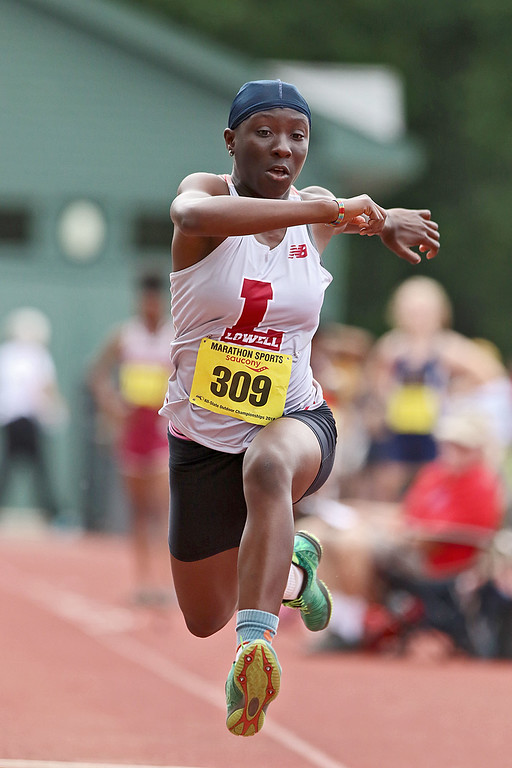 . Lowell High School junior Eunice Tabea competes in the triple jump during the All State Meet at Elliot Field Athletic Complex at Fitchburg State University on Saturday, June 2, 2018. SENTINEL & ENTERPRISE/JOHN LOVE