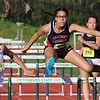 Central Catholic freshman Katharine Duren, center, competes in the 100 hurdles during the All State Meet at Elliot Field Athletic Complex at Fitchburg State University on Saturday, June 2, 2018. SENTINEL & ENTERPRISE/JOHN LOVE
