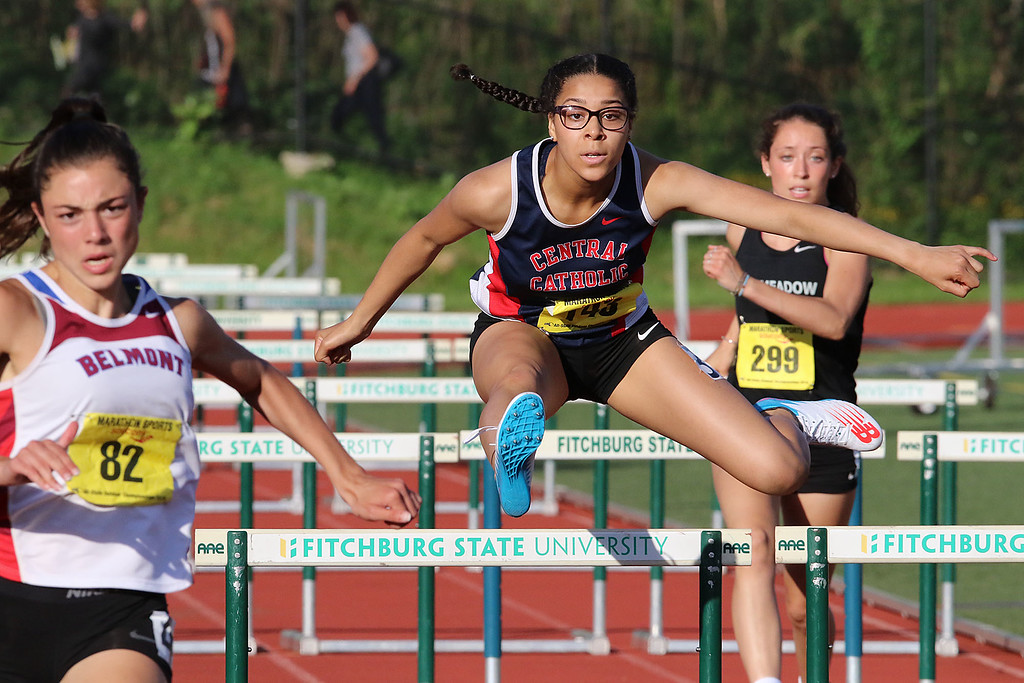 . Central Catholic freshman Katharine Duren, center, competes in the 100 hurdles during the All State Meet at Elliot Field Athletic Complex at Fitchburg State University on Saturday, June 2, 2018. SENTINEL & ENTERPRISE/JOHN LOVE