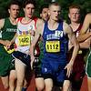 The first lap of the boys mile during the All State Meet at Elliot Field Athletic Complex at Fitchburg State University on Saturday, June 2, 2018. Center is Lunenburg Middle High School senior Chris McCauliff. SENTINEL & ENTERPRISE/JOHN LOVE