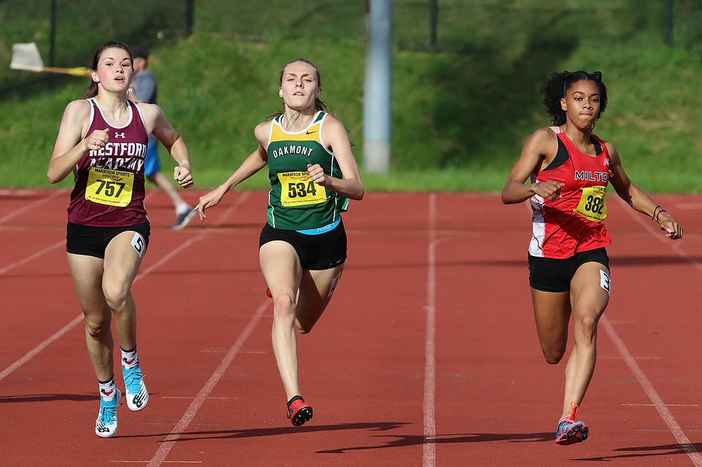. Westford Academy junior Jacki Harding, on left, Oakmont Regional High School junior Alyssa Madden, center,  and Milton High School sophomore Jayda Dillon competes in the 200 during the All State Meet at Elliot Field Athletic Complex at Fitchburg State University on Saturday, June 2, 2018. SENTINEL & ENTERPRISE/JOHN LOVE