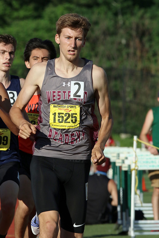 . Westford Academy senior Jason Dolan competes in the mile during the All State Meet at Elliot Field Athletic Complex at Fitchburg State University on Saturday, June 2, 2018. SENTINEL & ENTERPRISE/JOHN LOVE