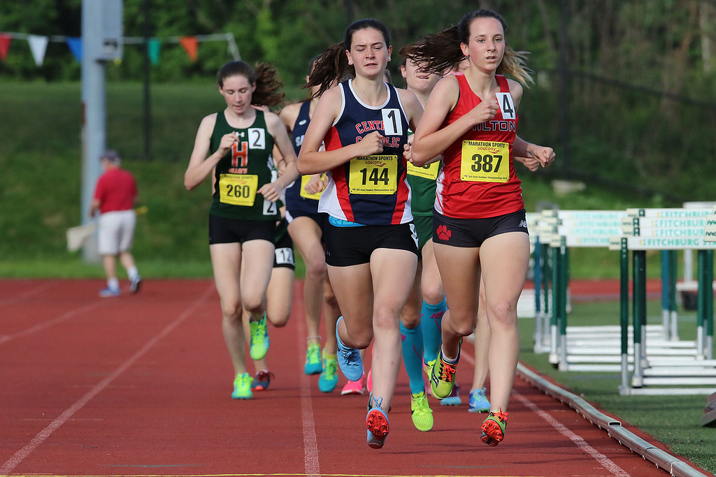 . From left leading the way n the mile is Central Catholic High School senior Sarah Freeman and Milton junior Eliza O\'Donnell during the All State Meet at Elliot Field Athletic Complex at Fitchburg State University on Saturday, June 2, 2018. SENTINEL & ENTERPRISE/JOHN LOVE