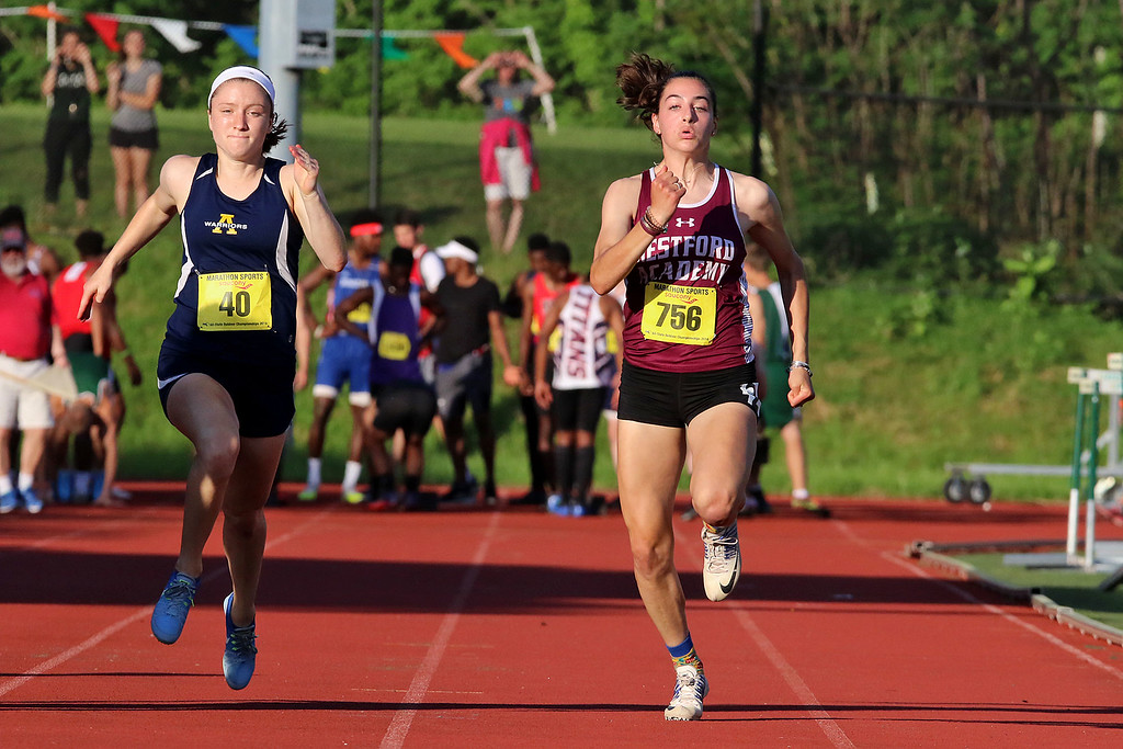 . Westford Academy junior Meline Almasian competes in the 100 during the All State Meet at Elliot Field Athletic Complex at Fitchburg State University on Saturday, June 2, 2018. SENTINEL & ENTERPRISE/JOHN LOVE