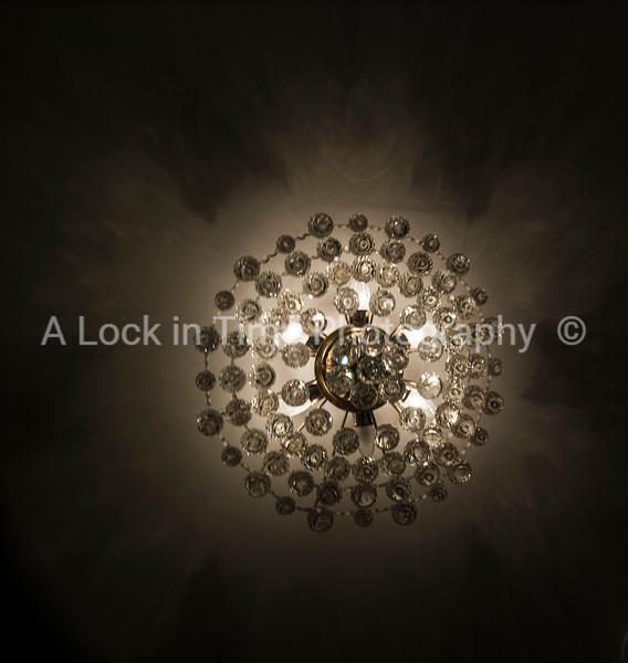 crystal light fixture in room