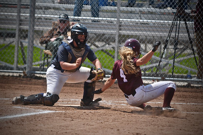 Katie McClure dominated from the circle in the elimination game on Friday as Alma downed Trine to win its first MIAA tournament title since 2010. (Sun photos by Paul Beroza)