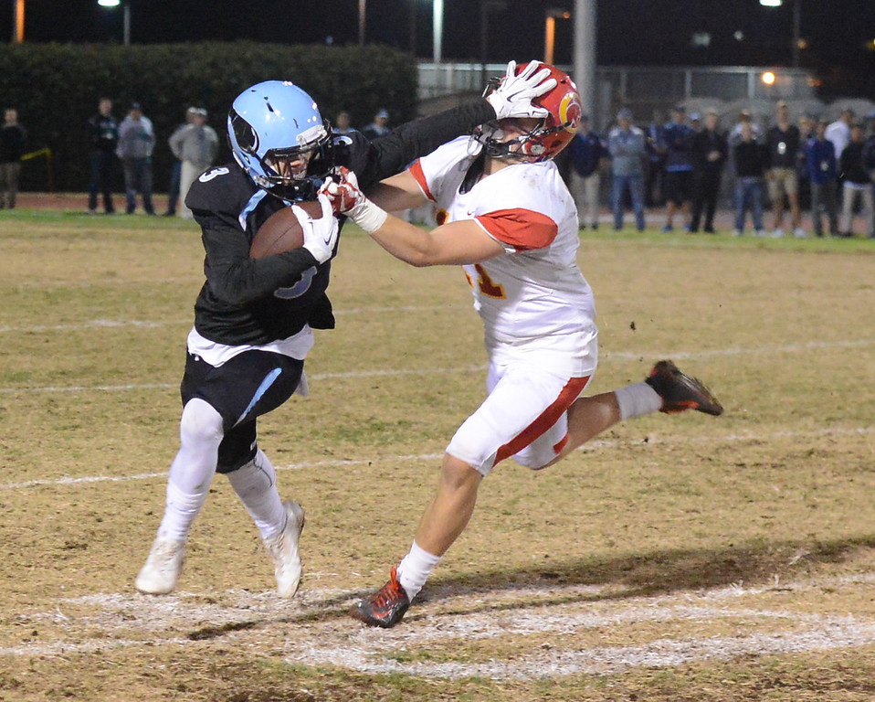. Pleasant Valley\'s Dante Martin pushes away from Chico High\'s Ty Walker during the 47th Almond Bowl title Friday October 20, 2017 in Chico, California. (Emily Bertolino -- Enterprise-Record)