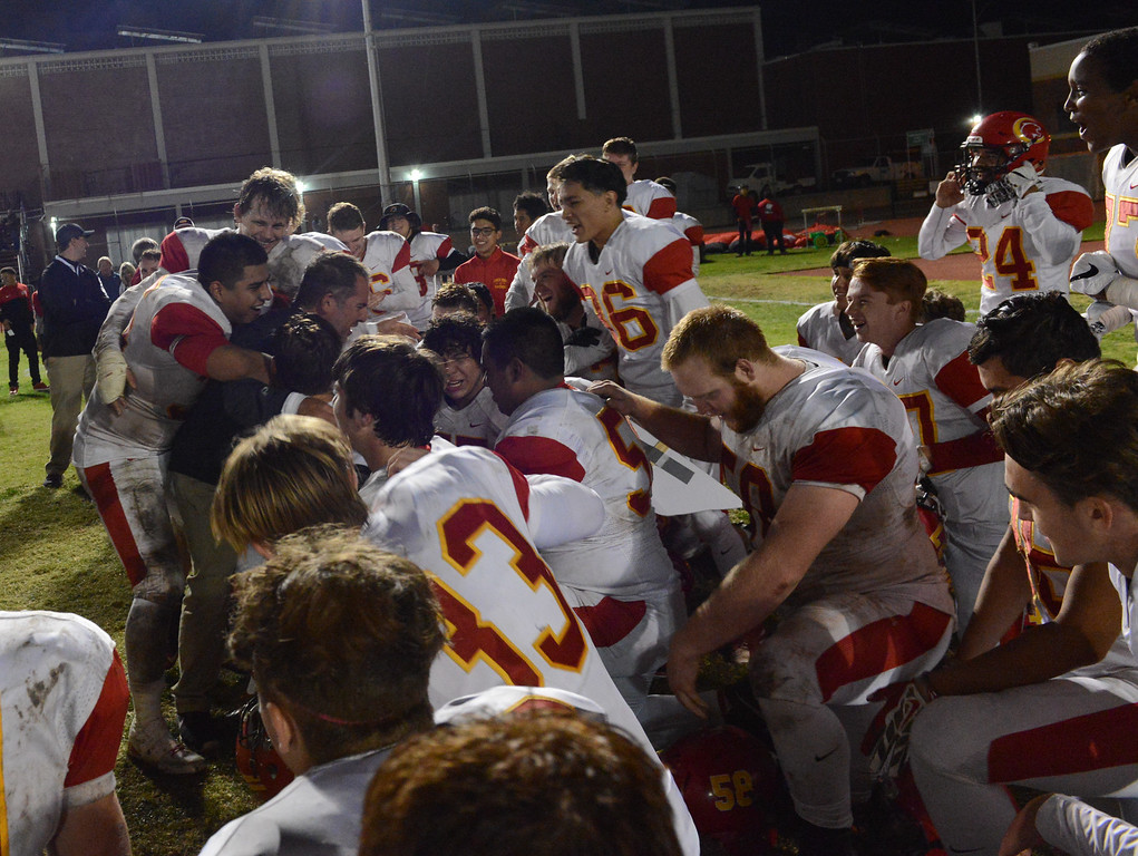 . The Chico High Panthers rally around head coach Jason Alvistur after they defeated the Pleasant Valley in the  47th Almond Bowl title Friday October 20, 2017 in Chico, California. (Emily Bertolino -- Enterprise-Record)