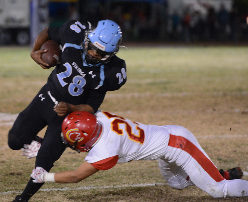 . Chico High\'s Raul Martinez brings down Pleasant Valley\'s Alex Torres as the teams battle for the 47th Almond Bowl title Friday October 20, 2017 in Chico, California. (Emily Bertolino -- Enterprise-Record)