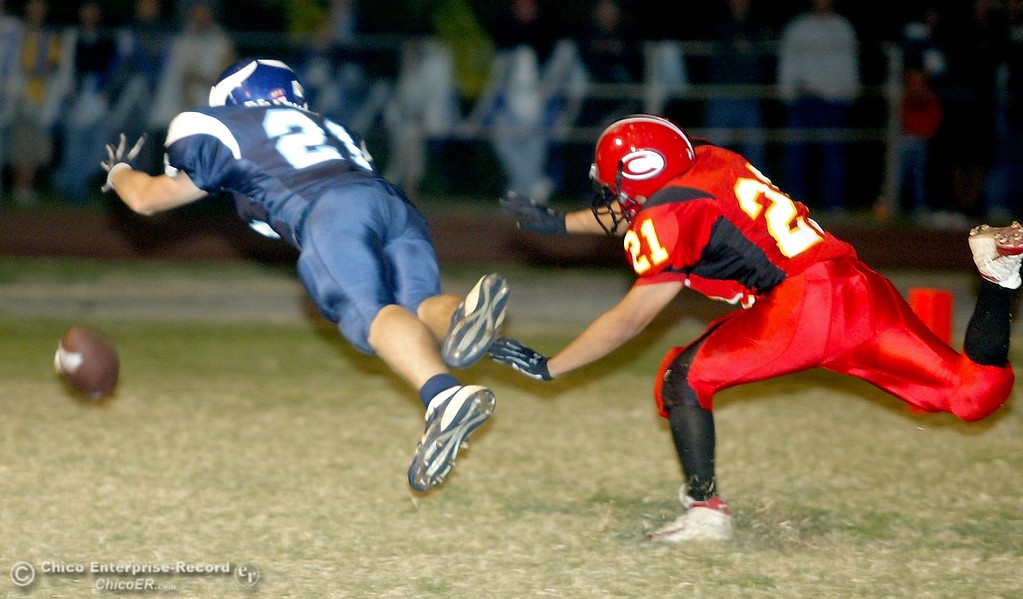 . PV High\'s #21 Shawn Reynolds (left) is unable to come up with a complete catch in the endzone against Chico High\'s #21 song Duong (right) with about 1:00 remaining in the second quarter in the 2006 Almond Bowl XXXVI football game at University Stadium Friday night. - halley photo 10/13/06
