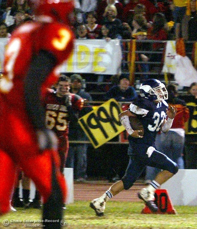 . Pleasant Valley High\'s #32 Evan Busby (right) rushes past the 30 yard line for a touchdown against Chico High at the end of the first quarter of their Almond Bowl XXXVII football game at CSUC University Stadium on Friday, October 12, 2007 in Chico, CA.  (Jason Halley/Chico Enterprise-Record)