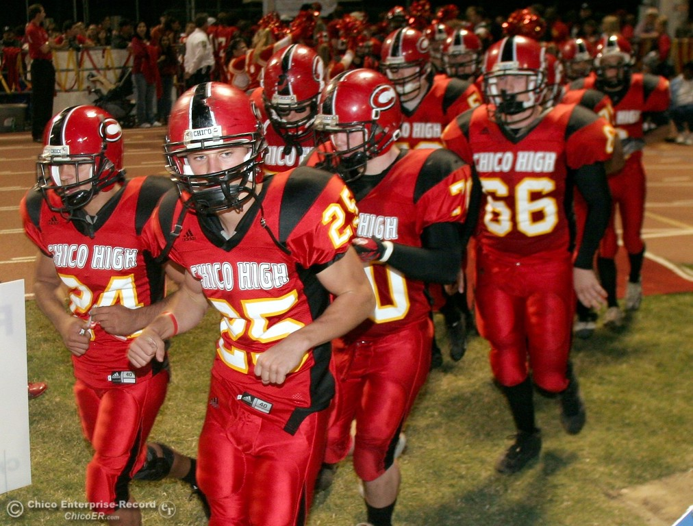 . Chico High\'s team runs onto the field against PV High in the 2006 Almond Bowl XXXVI football game at University Stadium Friday night. - halley photo 10/13/06