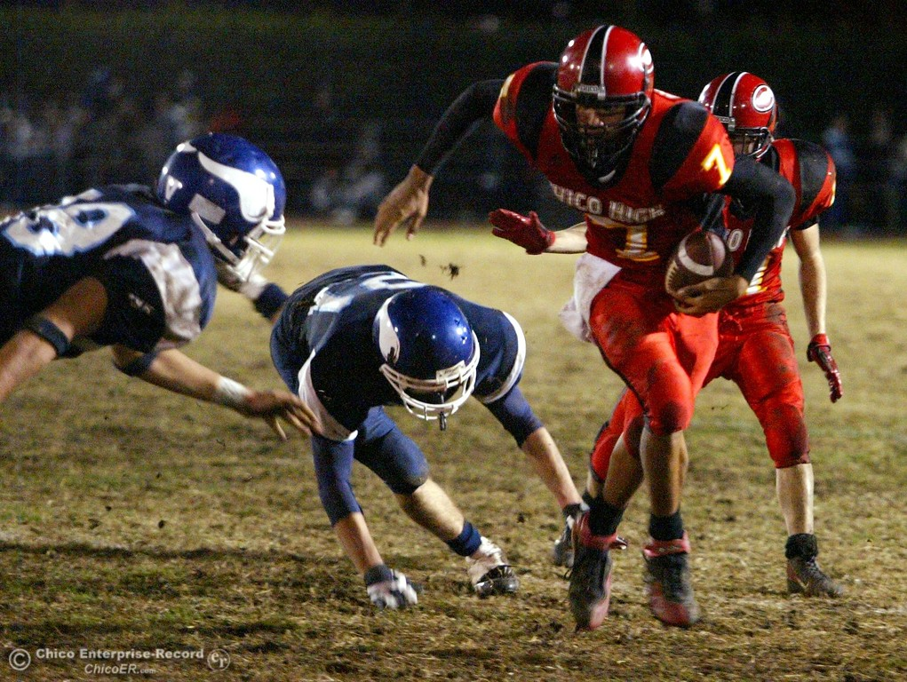. Chico High\'s #7 Nate Anderson (right) rushes against Pleasant Valley High with about 2:35 remaining in the second quarter of their Almond Bowl XXXVII football game at CSUC University Stadium on Friday, October 12, 2007 in Chico, CA.  (Jason Halley/Chico Enterprise-Record)