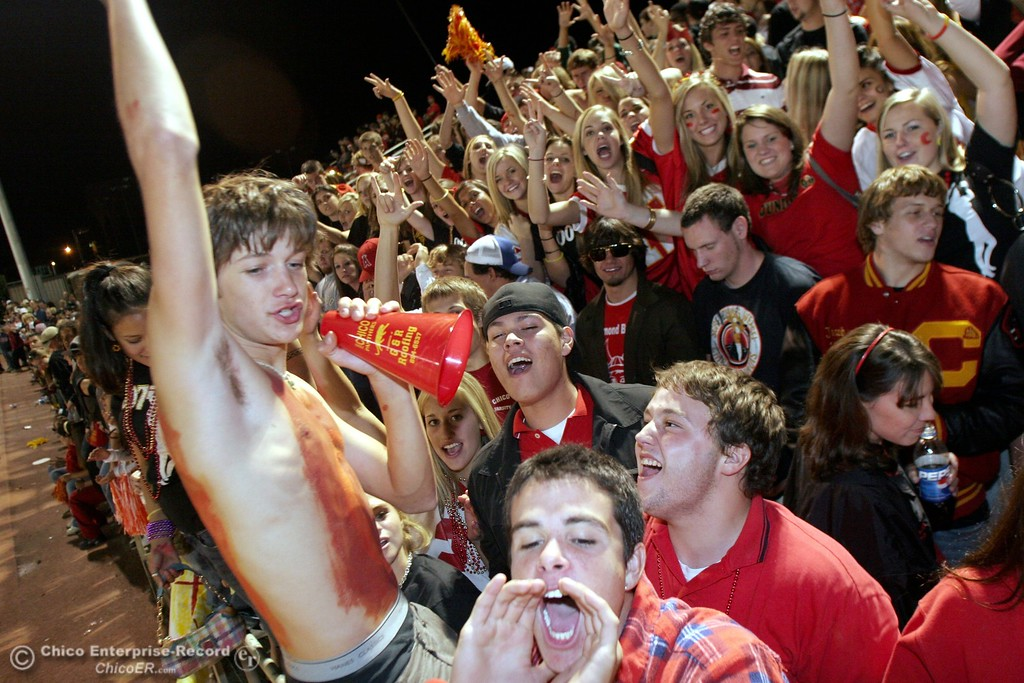 . Reggie Clodfelter II, 17 (left) gets Chico fans pumped against PV High in the 2006 Almond Bowl XXXVI football game at University Stadium Friday night. - halley photo 10/13/06