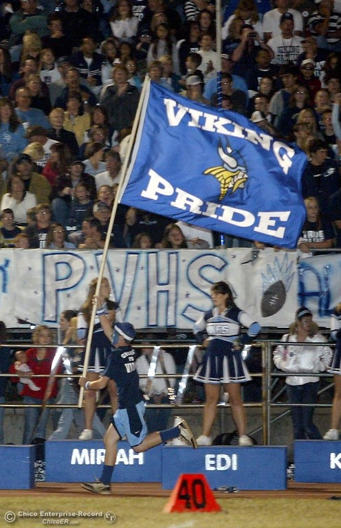 . PV\'s fans Colby Hammer, 14, runs with the flag across PV\'s side to cheer on football against Chico High in the 2006 Almond Bowl XXXVI football game at University Stadium Friday night. - halley photo 10/13/06