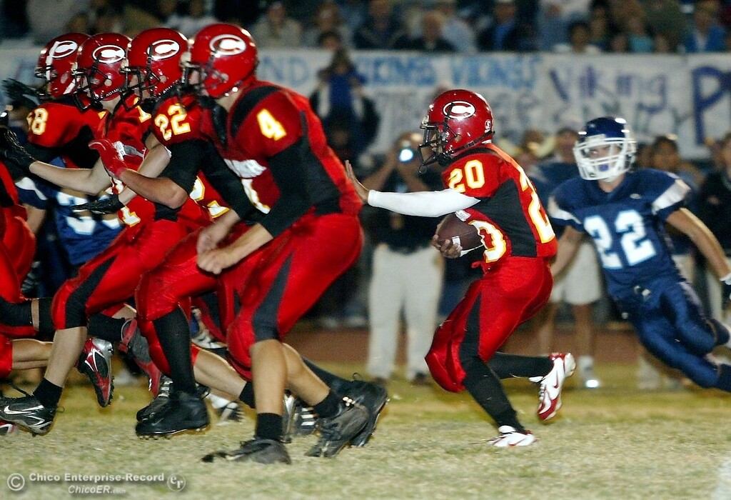 . Chico High\'s defensive line creates a wall for #20 Brett Scott (right) to rush near the 50yrd line against PV High with about 2:57 remaining in the first quarter in the 2006 Almond Bowl XXXVI football game at University Stadium Friday night. - halley photo 10/13/06