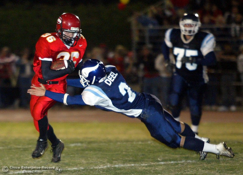. Chico\'s #36 ____ Carter evades the attempted tackle by PV\'s #2 Michael Deel with just under 4 minutes to go in the second quarter during the Almond Bowl Friday - halley photo 10/14/05