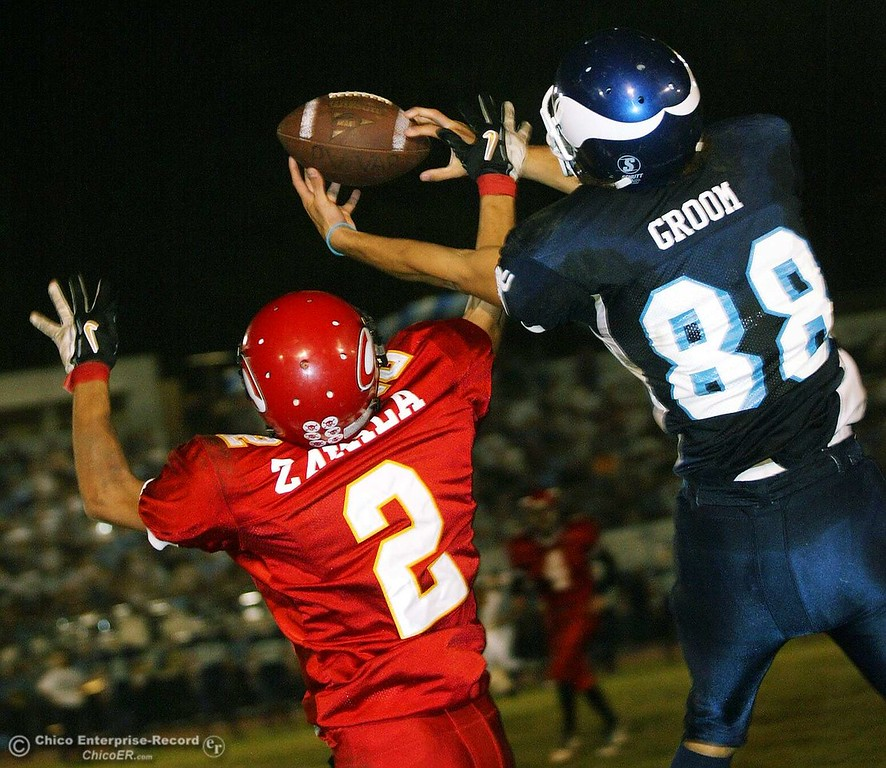 . Chico High DB Max Zavala breaks up a pass thrown to Pleasant Valley WR Ryan Groom Friday night at the 2004 Almond Bowl at University Stadium. photo by Glenn Fuentes sports 10/15/04