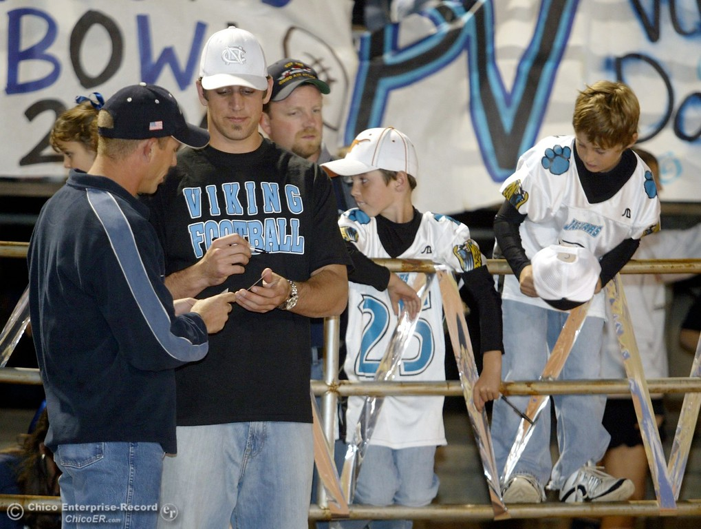 . Greenbay Packers QB Aaron Rodgers signs autographs as he made an appearance to watch his brother, PV\'s QB Jordan Rodgers play against Chico High in the 2006 Almond Bowl XXXVI football game at University Stadium Friday night. - halley photo 10/13/06