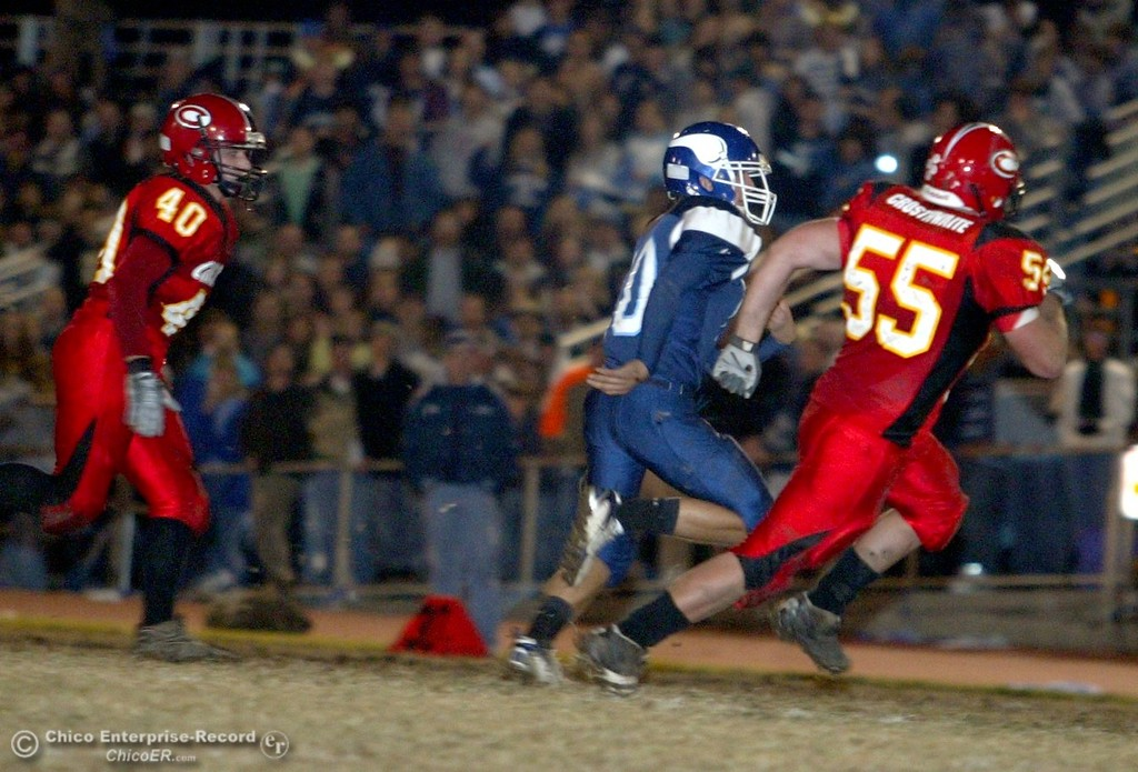 . Chico High against Pleasant Valley High near the 00 yard line with about 0:00 remaining in the first quarter of their Almond Bowl XXXVII football game at CSUC University Stadium on Friday, October 12, 2007 in Chico, CA.  (Jason Halley/Chico Enterprise-Record)