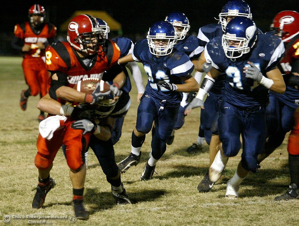 . Chico High\'s #9 Luis Santos (left) rushes against PV High to the 10 yrd line with about 11:53 remaining in the second quarter in the 2006 Almond Bowl XXXVI football game at University Stadium Friday night. - halley photo 10/13/06