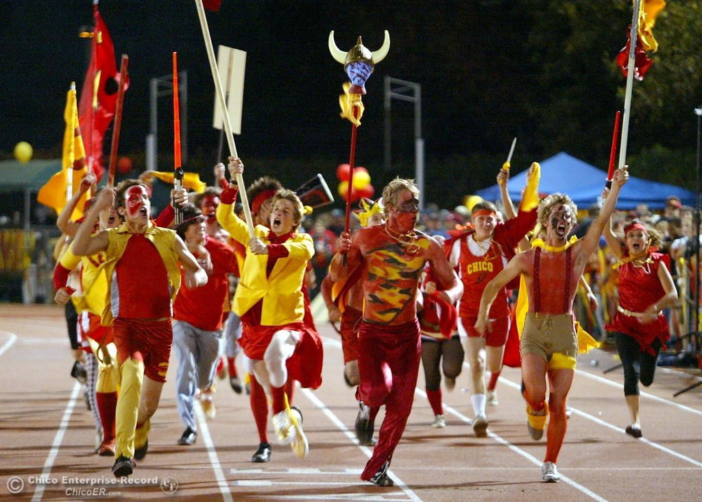 . Chico High fans charge up the crowd against Pleasant Valley High at the start of their Almond Bowl XXXVII football game at CSUC University Stadium on Friday, October 12, 2007 in Chico, CA.  (Jason Halley/Chico Enterprise-Record)