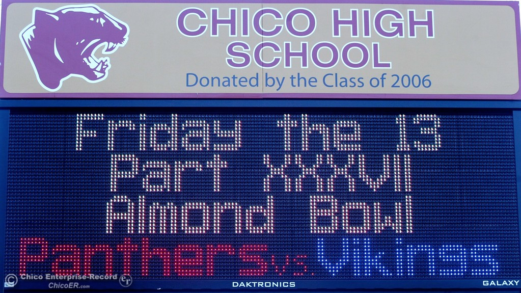 . A sign in front of Chico High School invites all to attend the XXXVI Almond Bowl Friday night.  Husa foto