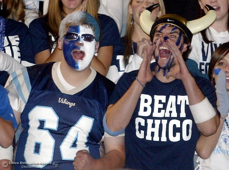 . PV\'s fans Eric Miller, 17 (left) and Ryan Fehling, 17 (right) cheer on football against Chico High in the 2006 Almond Bowl XXXVI football game at University Stadium Friday night. - halley photo 10/13/06