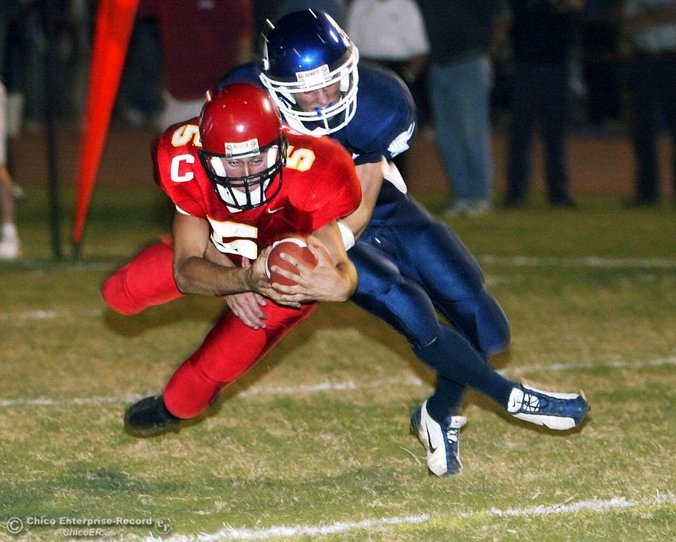 . Chico High QB Will Camy runs the ball in for a touchdown, as Pleasant Valley DB Chaz Cornellier tackles him in the first half Friday night in the 2004 Almond Bowl at University Stadium. photo by Glenn Fuentes sports 10/15/04