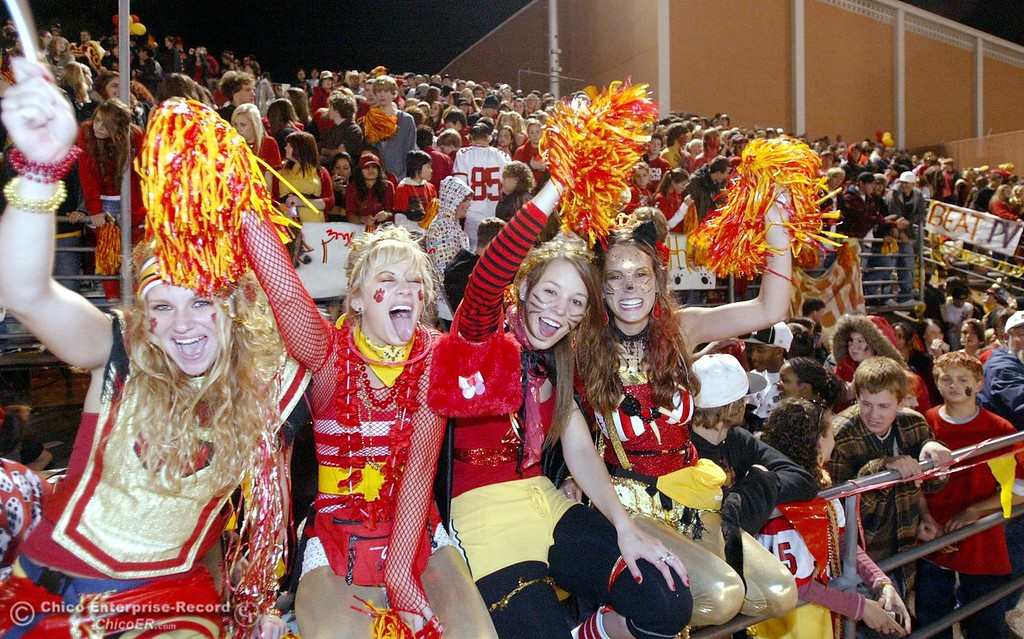 . Chico High Brittney Sheffield, Jade Elhardt, Chloe Vickers, and Oona Wellin, (left to right) cheer on their team against Pleasant Valley High at the start of halftime during their Almond Bowl XXXVII football game at CSUC University Stadium on Friday, October 12, 2007 in Chico, CA.  (Jason Halley/Chico Enterprise-Record)