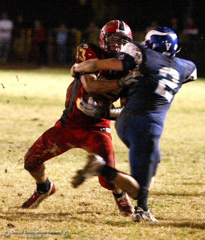 . Chico High\'s #33 Kayhan Karatekeli (left) is tackled against Pleasant Valley High\'s #2 Cody McHargue (right) with about 2:44 remaining in the second quarter of their Almond Bowl XXXVII football game at CSUC University Stadium on Friday, October 12, 2007 in Chico, CA.  (Jason Halley/Chico Enterprise-Record)
