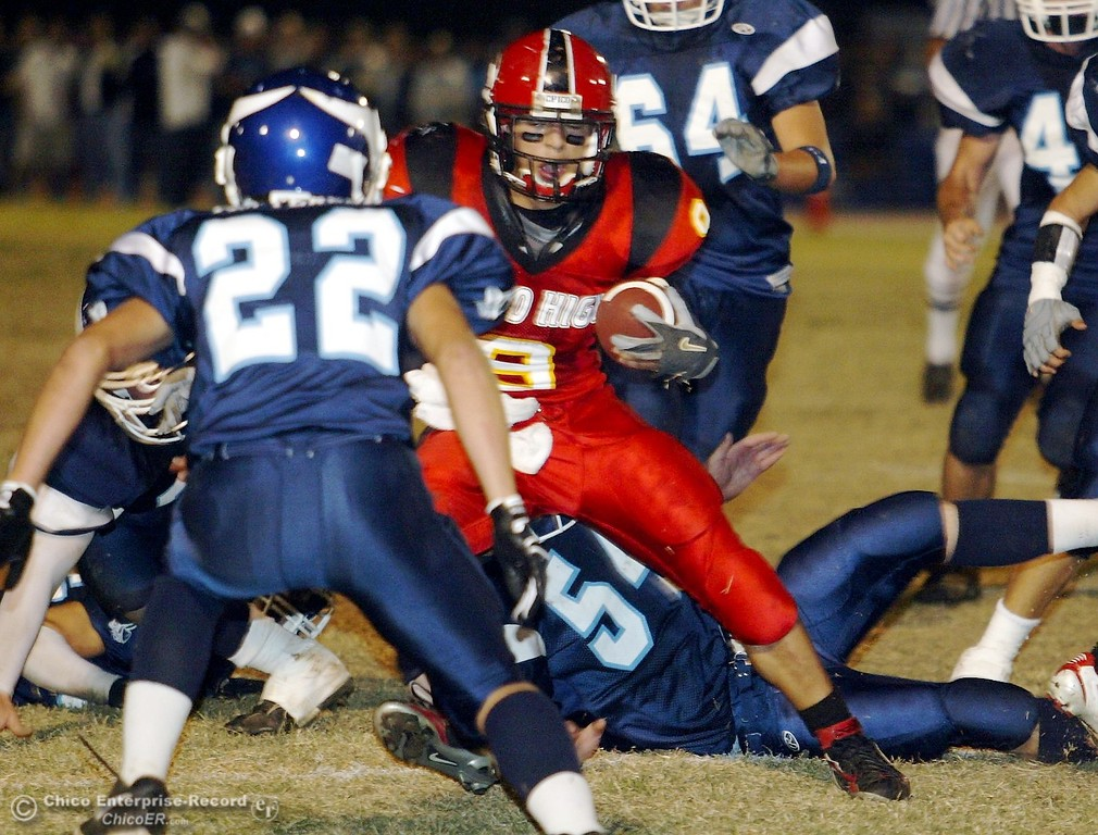 . Chico High\'s #9 Luis Santos (center) looks to avoid PV High\'s #22 Kyle Patterson (left) as he rushes to the 10 yrd line with about 11:53 remaining in the second quarter in the 2006 Almond Bowl XXXVI football game at University Stadium Friday night. - halley photo 10/13/06