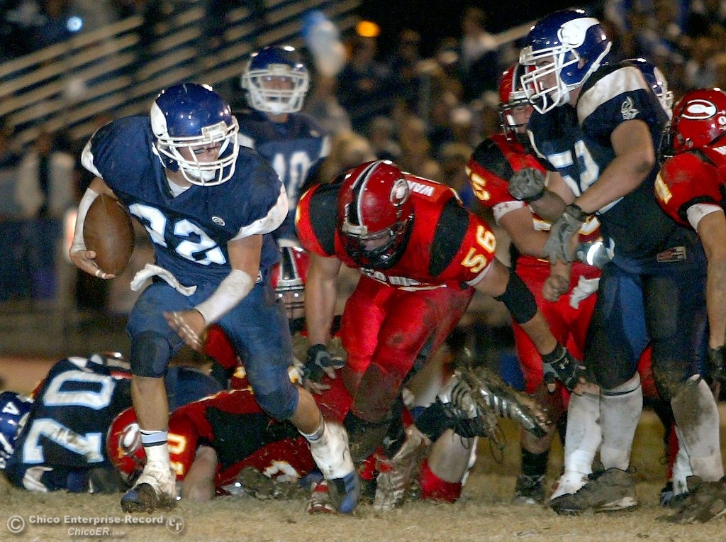 . Pleasant Valley High\'s #32 Evan Busby (left) left rushes against Chico High with about 5:42 remaining in the second quarter of their Almond Bowl XXXVII football game at CSUC University Stadium on Friday, October 12, 2007 in Chico, CA.  (Jason Halley/Chico Enterprise-Record)