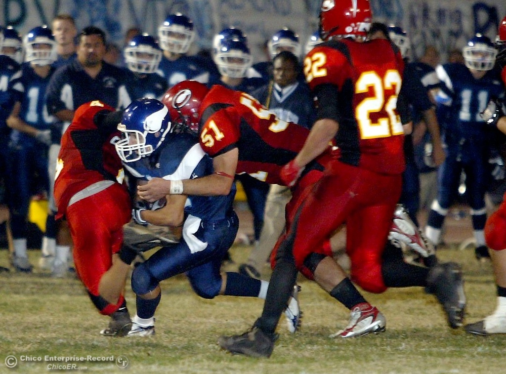 . PV High\'s #15 Blake Page (second from left) is tackled near the 15yrd line by Chico High\'s #4 Andrew Medearis (left) and #51 Joe Hulen (center) with 0:47 remaining in the second quarter in the 2006 Almond Bowl XXXVI football game at University Stadium Friday night. - halley photo 10/13/06