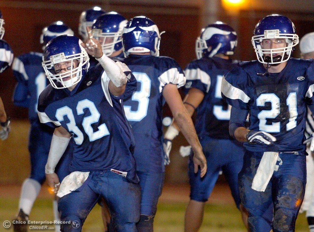 . Pleasant Valley High\'s #32 Evan Busby (left) reacts to rushing in for a touchdown against Chico High at the end of the first quarter of their Almond Bowl XXXVII football game at CSUC University Stadium on Friday, October 12, 2007 in Chico, CA.  (Jason Halley/Chico Enterprise-Record)