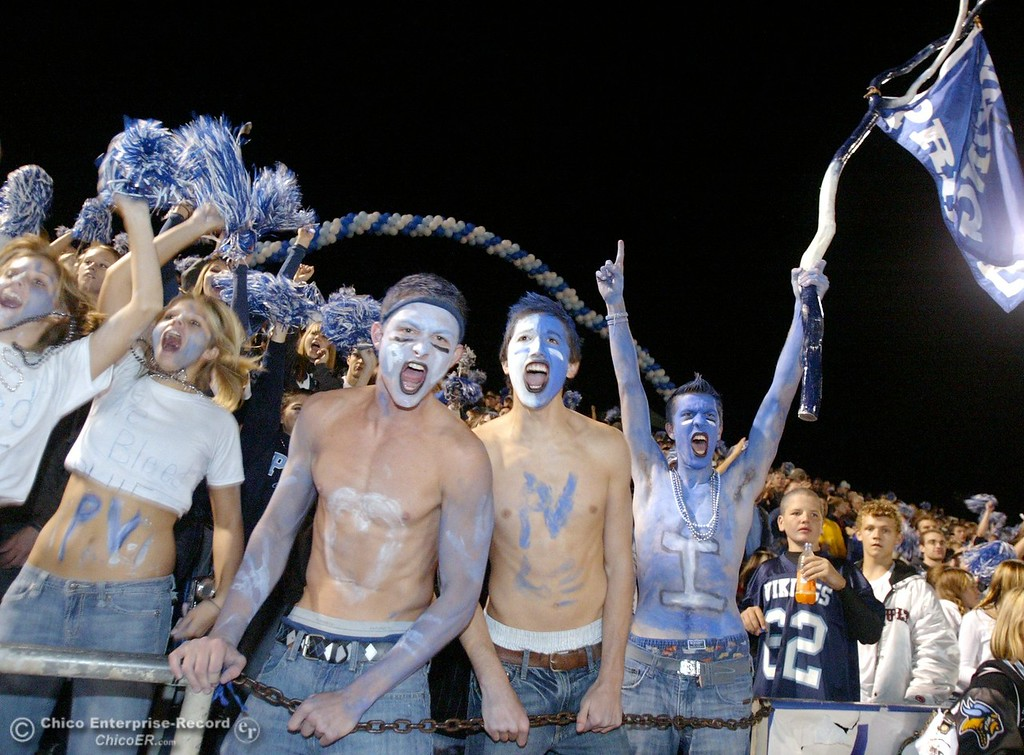 . Pleasant Valley High fans David Halladay, James Agoff, and Scott Deter (left to right) cheer on their team against Chico High in the first quarter of their Almond Bowl XXXVII football game at CSUC University Stadium on Friday, October 12, 2007 in Chico, CA.  (Jason Halley/Chico Enterprise-Record)