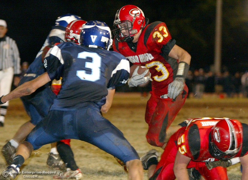 . Chico High\'s #33 Kayhan Karatekeli (right) rushes in for a touchdown against Pleasant Valley High\'s #3 Mycal Swaim (left) with about 8:05 remaining in the second quarter of their Almond Bowl XXXVII football game at CSUC University Stadium on Friday, October 12, 2007 in Chico, CA.  (Jason Halley/Chico Enterprise-Record)