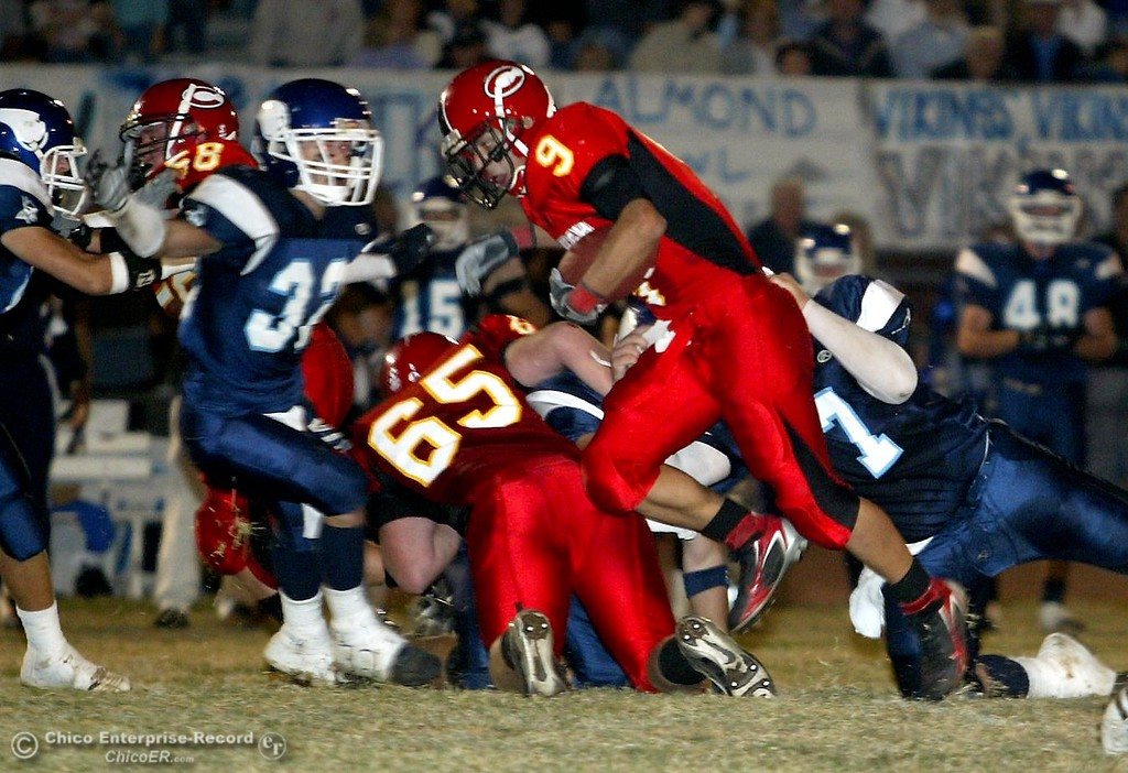 . Chico High\'s #9 Luis Santos (center) is tackled by PV High\'s #37 Addison Dwyer (left) and #7 Michael Deel (right) with about 1:00 remaining in the first quarter in the 2006 Almond Bowl XXXVI football game at University Stadium Friday night. - halley photo 10/13/06